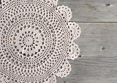 stock photo of doilies  - Crochet doily over the old grey wooden table - JPG