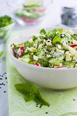 stock photo of tabouleh  - Bowl full of fresh couscous salad with cucumber and radish - JPG