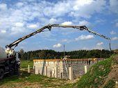 pic of concrete pouring  - truck mixer pump is preparing to pour the concrete slab built home  - JPG