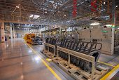 stock photo of assembly line  - Building cars in large modern car factory - JPG