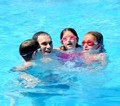 stock photo of swimming pool family  - Family having fun in swimming pool - JPG