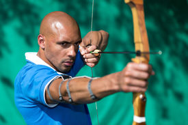 picture of longbow  - archer at shooting range with bow and arrow - JPG