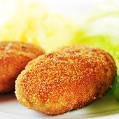pic of pork cutlet  - roasted cutlets of pork with potato and lettuce [[** Note: Shallow depth of field ** Note: Visible grain at 100%, best at smaller sizes - JPG