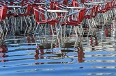 picture of flood  - reflection on the water of table and red chairs in Venice ITALY during the flood - JPG