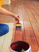 pic of wood craft  - hand painting oil color on wood floor use for home decorated house renovation and housing construction theme - JPG