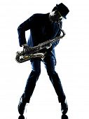 stock photo of saxophone player  - one caucasian man  saxophonist playing saxophone player in studio silhouette isolated on white background - JPG