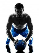 picture of exercise  - one caucasian man exercising fitness weights Medicine Ball push ups exercises in studio silhouette isolated on white background - JPG