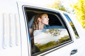 image of limousine  - Bride looks out of the window a white limousine - JPG