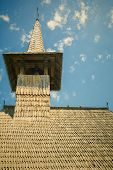 stock photo of blue-bell  - Wooden Bell Tower Under The Blue Sky - JPG