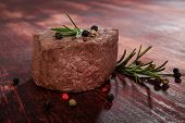 picture of peppercorns  - Luxurious sirloin steak on wooden background with peppercorn and herbs - JPG