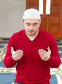 picture of muslim kids  - Photo of the Young muslim man showing Islamic prayer - JPG