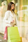 image of shopping center  - Beauty woman with shopping bags in shopping mall - JPG