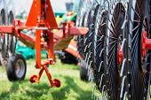 foto of machinery  - Hay rake farm machinery equipment in agricultural or farmland industry - JPG