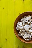 picture of champignons  - Whole Champignons in a Bowl on Wooden Boards closeup - JPG