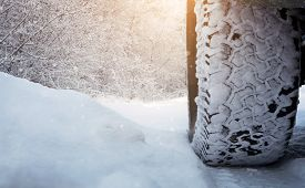 image of slippery-roads  - Close up of car tire on the snowy road with copy space - JPG