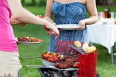 foto of frazzled  - Host serving grilled meals on barbecue party - JPG
