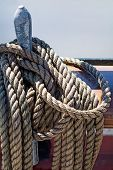 foto of sailing vessels  - ropes braided in bays on an ancient sailing vessel vertical selected focus - JPG