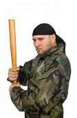 stock photo of truncheon  - Young man in soldier uniform holding bludgeon isolated on white - JPG