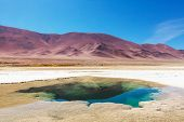 stock photo of salt mine  - Ojo del Mar in a salt desert in the Jujuy Province - JPG