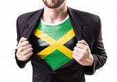 image of rastafari  - Businessman stretching suit with Jamaica Flag on white background - JPG