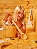 picture of sauna woman  - Young blond woman liying in sauna - JPG
