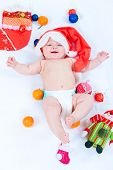 picture of new years baby  - The image of the kid lying among New Year - JPG