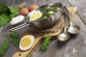 pic of sorrel  - Sorrel soup with egg on wooden table - JPG