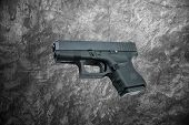 image of handgun  - automatic 9mm - JPG