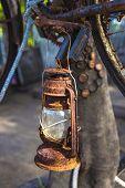 picture of kerosene lamp  - Vintage Old Kerosene Lamp outdoors on a tree - JPG