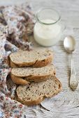 pic of whole-grain  - homemade whole grain bread with pecans and Greek yogurt on a light wooden background - JPG