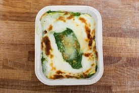 pic of borage  - lasagna with borage and bechamel inside earthenware bowl - JPG