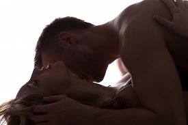 foto of intimate  - Sexy lovers kissing and playing in bed - JPG