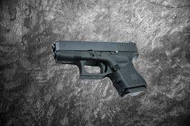 foto of handgun  - automatic 9mm - JPG