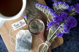 picture of peppermint  - peppermint on spoon and tea bag put on wooden board - JPG