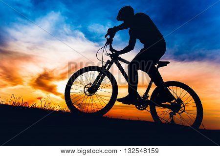 Man On Mountain Bike At Sunset, Riding Bicycle On Hills