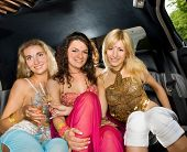 stock photo of hen party  - Three beautiful women in a limousine - JPG