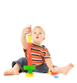 foto of child development  - Beautiful young child playing intellectual game - JPG