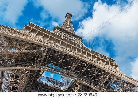 poster of Low angle view of Eiffel Tower against clouds in sky, Paris, France