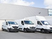 Specialized Delivery Society Parking With Small Trucks And Van poster