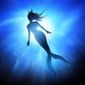 A Swimming Mermaid Silhouette With A Long Fish Tail In The Deep Blue Sea. Mythical Creature Of The O poster