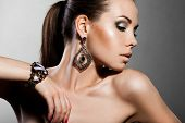 stock photo of jewelry  - elegant fashionable woman with silver jewelry - JPG