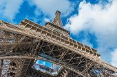 Low angle view of Eiffel Tower against clouds in sky, Paris, France poster