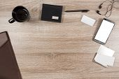 Top View On Wooden Desk With Smartphone With Empty Copy Space, Black Headphone Earpieces And Cables, poster