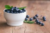 Fresh Blueberries Heap In White Bowl In Side View. Wild Blueberries In Cup On Wood Table With Copy S poster