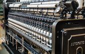 Vintage Automatic Loom And White Cotton Threads Rows poster