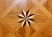 stock photo of marquetry  - Wood marquetry star shape at floor parquet - JPG