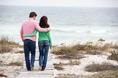 picture of walking away  - Couple walking by the sea - JPG