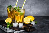 Iced Tea. Summer Cold Drink With Black Tea, Lemon, Mint And Ice. poster