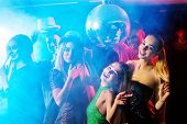 Dance party with group people dancing. Women and men have fun in night club. Rest after hard day at  poster