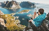 Man Traveler Taking Aerial Photo By Smartphone Sitting On Cliff Travel Lifestyle Concept Adventure O poster